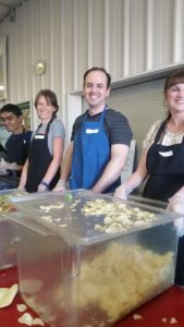 Happy Humanists serving dinner to the homeless.